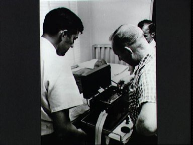 Astronaut John Glenn having an electrocardiograph done during medical testing