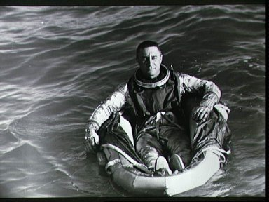 Astronaut Virgil Grissom in life raft during water egress training activies