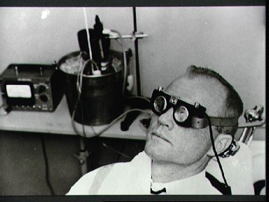 Astronaut John Glenn tests balance mechanism performance