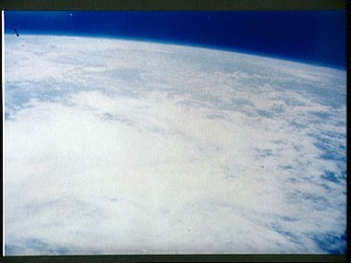 Earth and sky views taken with hand-held camera during Mercury-Atlas 7