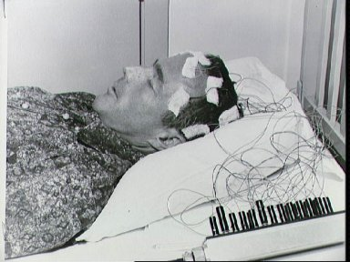 Astronaut Scott Carpenter has biosensors attached to body during training