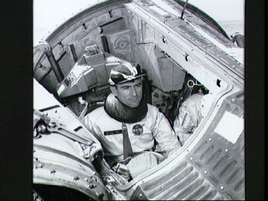 Astronaut John Young making final check of spacecraft systems before training