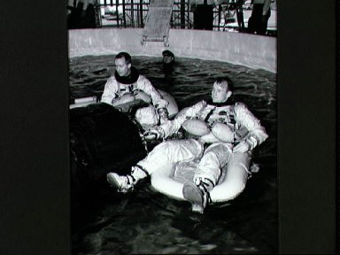 Astronauts McDivitt and White during water egress training at Ellington AFB