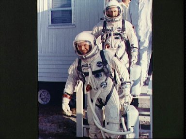 Astronauts Cooper and Conrad leave suiting trailer at Pad 16 during countdown