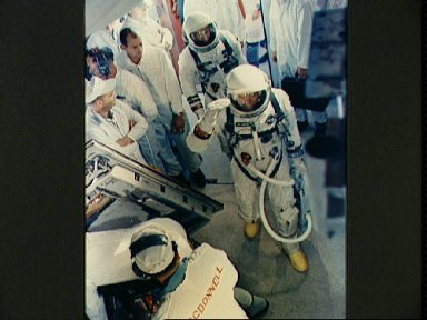 Astronauts Cooper and Conrad arrive in white room at Pad 19 during countdown