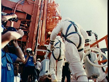 Astronauts Cooper and Conrad walk up gantry ramp at Pad 19 during countdown