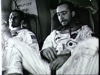 Gemini 4 astronauts relax aboard Navy helicopter after recovery