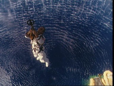 Astronauts Charles Conrad hoisted up to Navy helicopter after splashdown