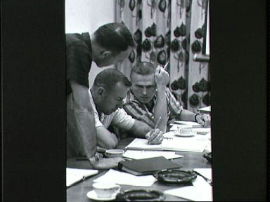 Astronauts Lovell and Borman review mission requirements for Gemini 7