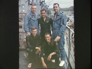 Gemini 8 crew stands on deck of recovery vessel
