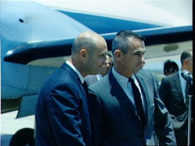 Gemini 9-A astronauts talk to reporters at Ellington field at end of mission