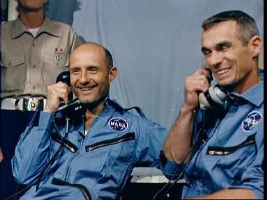 Astronauts Stafford and Cernan talk to President Johnson from U.S.S. Wasp