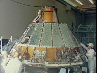 View of Spacecraft 012 Command Module during installation of heat shield