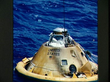 Apollo spacecraft 011 Command Module during recovery operations