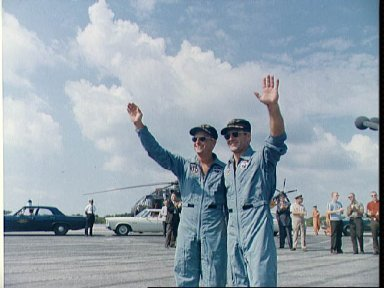 Astronauts Conrad and Gordon wave to crowd at Cape Kennedy skid strip