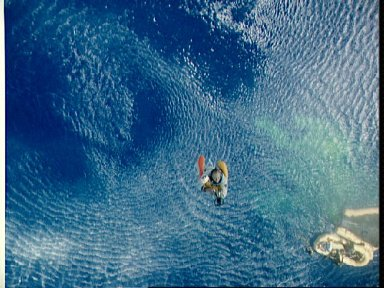 Astronaut Charles Conrad hoisted aboard recovery helicopter