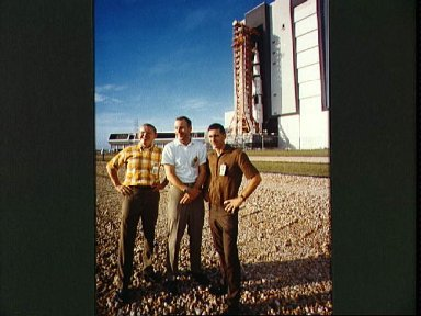 Apollo 8 prime crew in foreground as spacecraft leaves VAB on way to pad