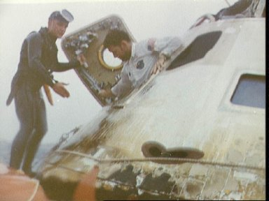 Astronaut Walter Schirra egresses spacecraft during recovery operations