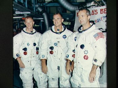 Apollo 9 prime crew stands in front of Apollo Command Module 103 after tests