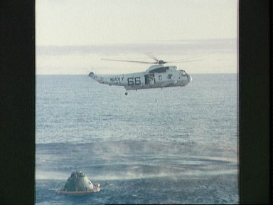 Apollo 10 crewmember is pickup by recovery helicopter
