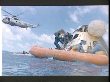 Astronaut Alan Bean assisted with egressing command module after landing