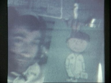 Astronaut John Young displays drawing of Charlie Brown