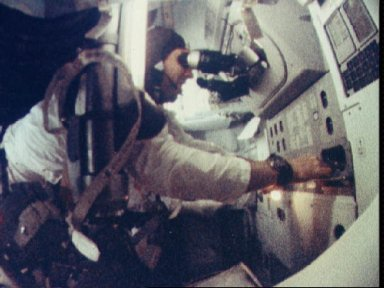 Astronaut James Lovell seen at Spacecraft guidance and navigation station