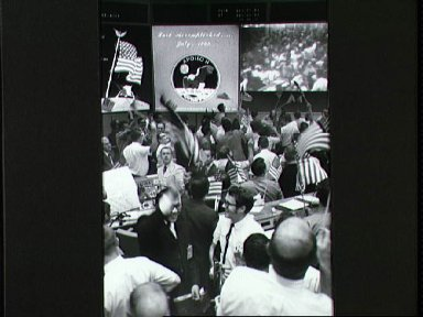 View of Mission Control Center celebrating conclusion of Apollo 11 mission