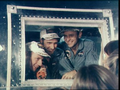 Apollo 12 crewmembers greeted by family on arrival at Ellington