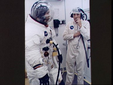 Astronaut Fred Haise in suiting room prior to launch
