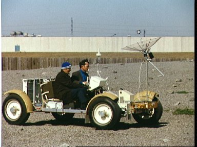 Astronaut John Young drives in One-G Lunar Roving Vehicle during simulation