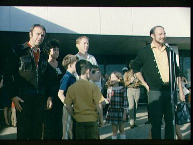 Astronaut Edgar Mitchell addresses MSC personnel and news media