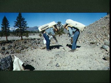 Astronauts Young and Duke in geology training and EVA simulation