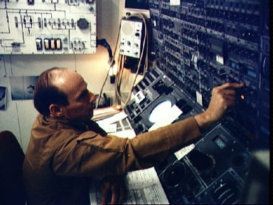Astronaut Charles Conrad Jr. working with control panel in Skylab simulation