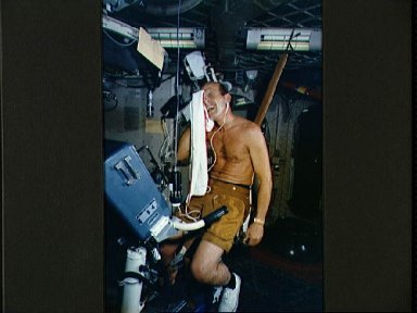 Astronaut Charles Conrad following exercise session on bicycle ergometer