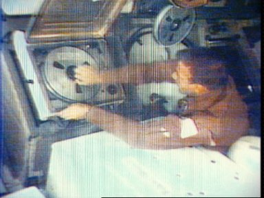 Overhead view of Astronaut Paul Weitz at video tape recorder