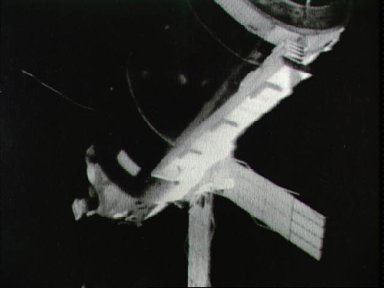 View of the Skylab 1 space station cluster from the Skylab 2 Command Module