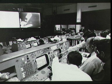 Flight directors for Skylab 1 and 2 mission around console in Mission Control