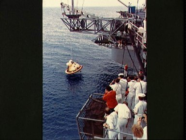 Skylab 2 Command Module is hoisted aboard prime recovery ship