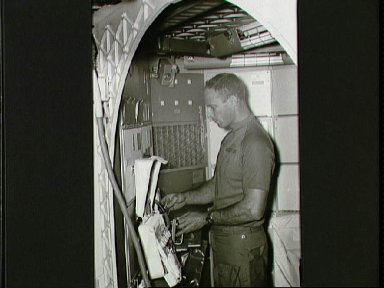 Astronaut Jack Lousma with part of Inflight Medical Support System