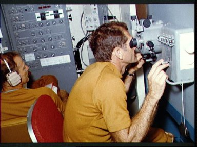 Astronaut William Pogue using Skylab Viewfinder Tracking System experiment