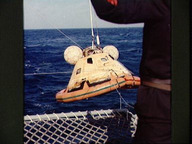 Skylab 3 Command Module is hoisted aboard prime recovery ship