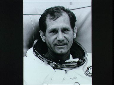 Astronaut William Pogue during spacesuit pressure and fit checks at KSC