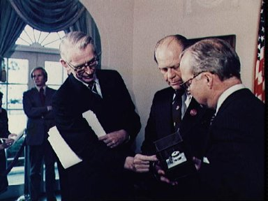 President Gerald Ford holds crystal manufactured in space during Skylab 4