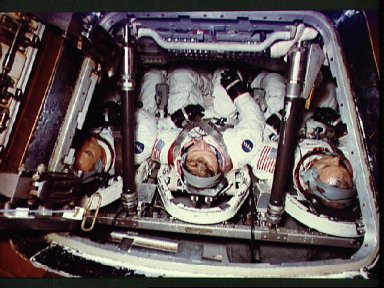 ASTP crewmen in Apollo Command Module Trainer during training session at JSC