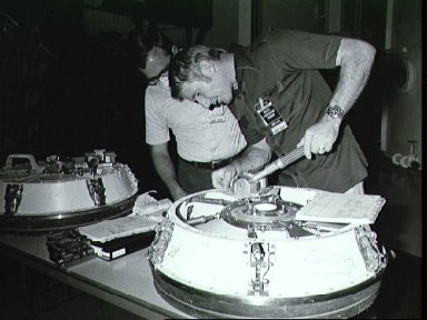 Astronaut Vance Brand practices operating Docking Module hatch for ASTP