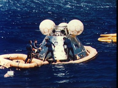 Navy swimmers assit with recovery of ASTP Apollo Command Module