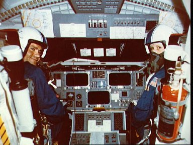 Astronauts Haise and Fullerton in cockpit of Orbiter 101 prior to fifth ALT