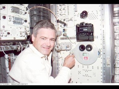 Astronaut Marc Garneau, mission specialist representing the Canadian Space Agency (CSA), stands at the Commercial Float Zone Furnace (CFZF) in the Spacehab Module onboard the Earth-orbiting Space Shuttle Endeavour.