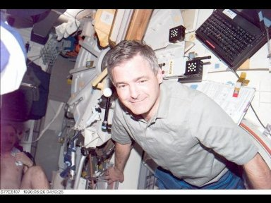 Astronaut Marc Garneau, mission specialist representing the Canadian Space Agency (CSA), poses for a photograph onboard the mid-deck of the Earth-orbiting Space Shuttle Endeavour.